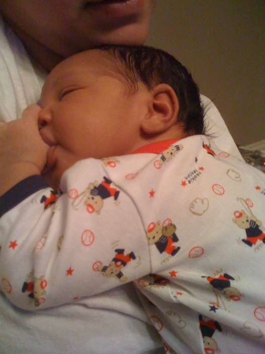 a peek at tpains new baby a picture of lyriq and muziq