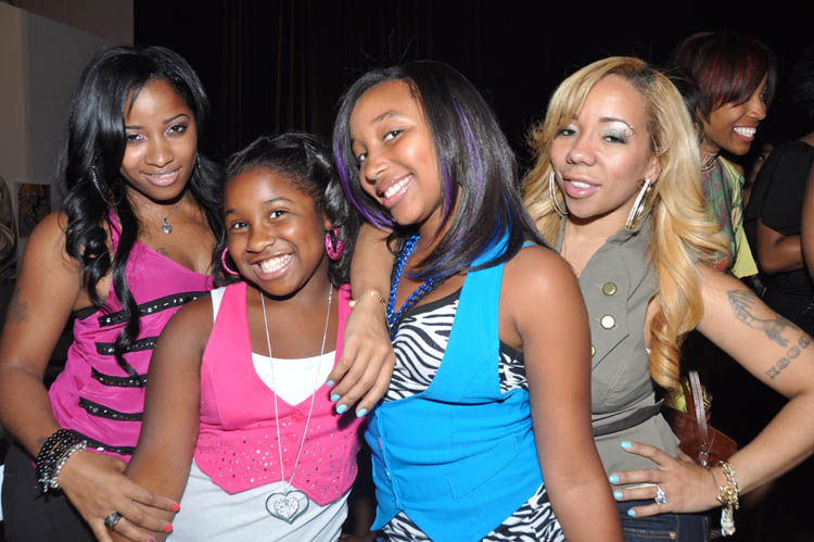 a fashion show with tiny toya kandi and their daughters