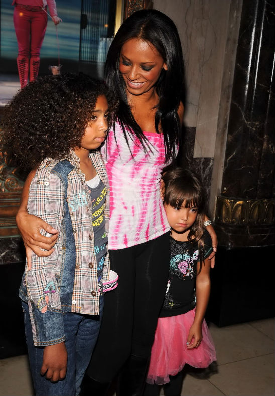 MELANIE BROWN(MEL B) AND GIRLS TAKE IN A MUSICAL SHOW North West Baby Vogue