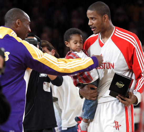 TREVOR ARIZA AND SON ARE RING BEARERS