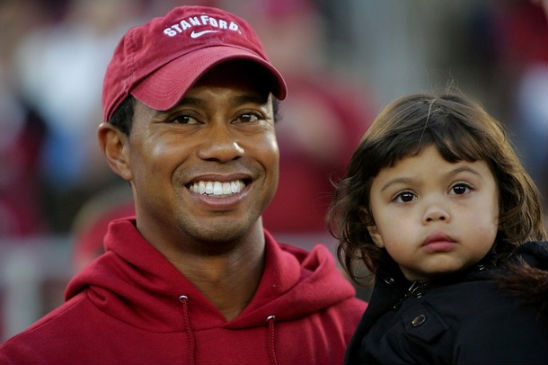tiger woods enjoys a game with his daughter