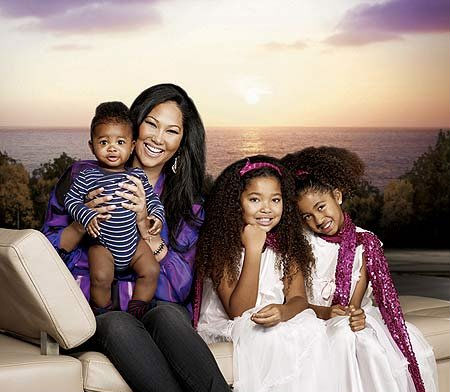 Hi-Res picture: Kimora is pictured with her children Kenzo, Ming, and Aoki