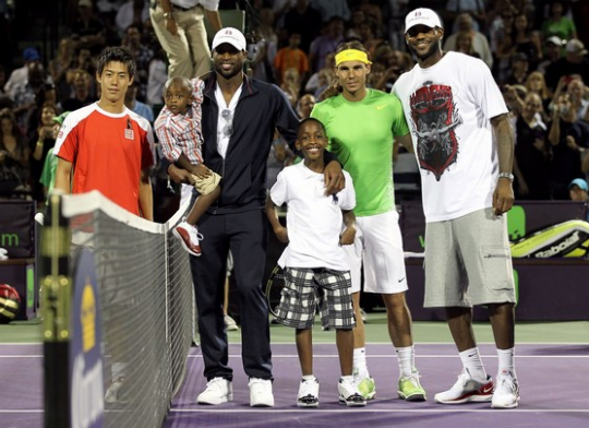 DWYANE WADE AND SONS ATTEND A TENNIS MATCH