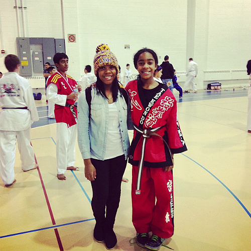 ANDREA KELLY AND KIDS AT TAE KWON DO COMPETITION
