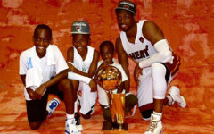 Dwyane with kids and trophy