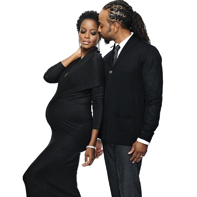 Tomiko poses with husband while pregnant with twins.