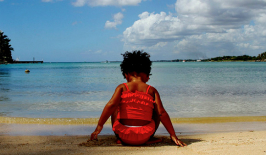 During a recent vacation to Jamaica,  Blue wore this cute ruffled red bathing suit and so did her mama(not pictured).