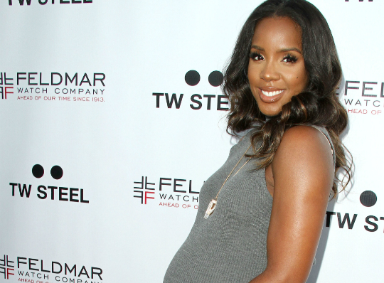 KELLY ROWLAND DEBUTS WATCH LINE WHILE SHOWING OFF BABY BUMP