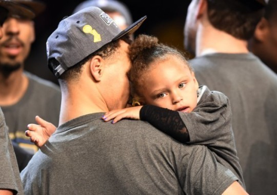 Jun 16, 2015; Cleveland, OH, USA; Golden State Warriors guard Stephen Curry (30) holds his daughter Riley Curry after beating the Cleveland Cavaliers in game six of the NBA Finals at Quicken Loans Arena. Mandatory Credit: Bob Donnan-USA TODAY Sports