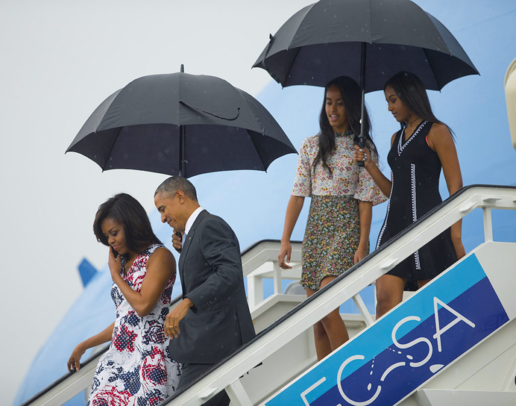President Barack Obama, second from left, arrives with first lady Michelle Obama, left, and their daughters Sasha, right, and Malia, as they exit Air Force One at the airport in Havana, Cuba, Sunday, March 20, 2016. Obama and his family are traveling to Cuba, the first U.S. president to visit the island in nearly 90 years.. (AP Photo/Pablo Martinez Monsivais)