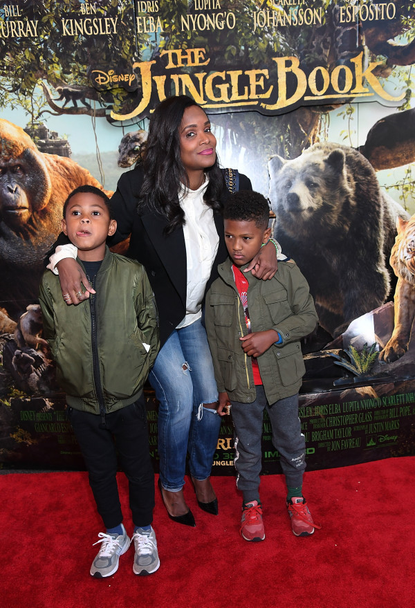"""ATLANTA, GEORGIA - APRIL 09: (L-R) Usher Raymond V, Tameka Foster Raymond and Naviyd Raymond attend ""The Jungle Book"" advanced screening on April 9, 2016 at Regal Cinemas Atlantic Station in Atlanta, Georgia. (Photo by Paras Griffin/Getty Images for Disney/The Jungle Book )"""