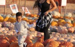 Daphne Joy and son Sire Jackson go pumpkin picking.