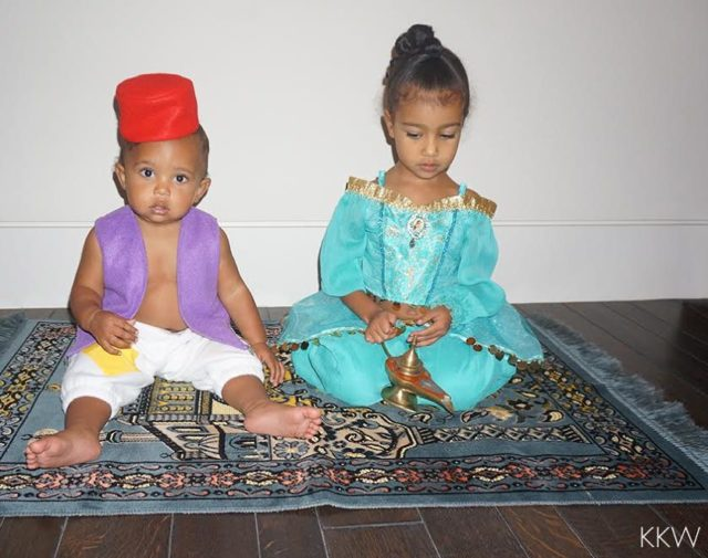Saint West does Halloween with big sister North West.