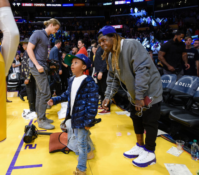 RARE SIGHTING! LIL WAYNE AND SON TAKE IN A BALL GAMELauren London And Lil Wayne Baby
