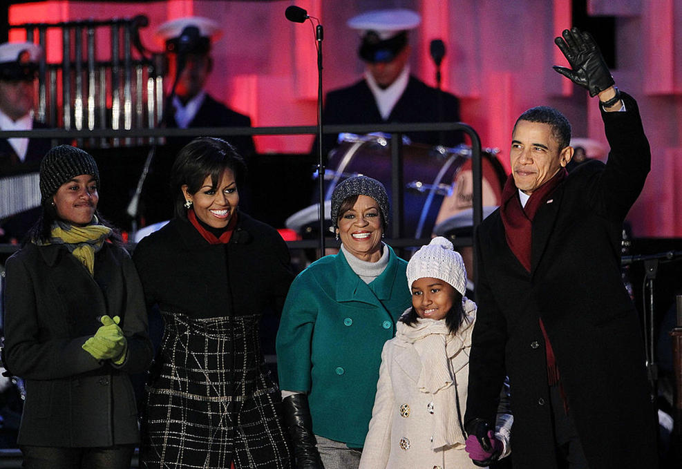 The president waves to the crowd at the 2010 ceremony. Sasha is all smiles while holding her dad's hand.