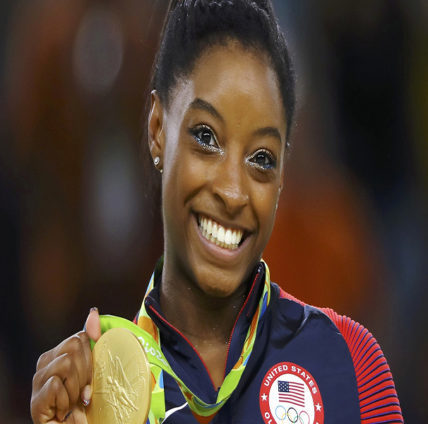 Simone Biles (USA) of USA poses with her gold medal on the podium. 2016 Rio Olympics - Women's Floor Victory Ceremony - Rio Olympic Arena - Rio de Janeiro, Brazil - 16/08/2016.