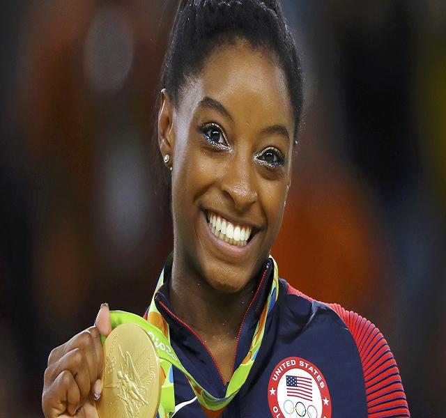 Simone Biles (USA) of USA poses with her gold medal on the podium. 2016 Rio Olympics - Women's Floor Victory Ceremony - Rio Olympic Arena - Rio de Janeiro, Brazil - 16/08/2016.