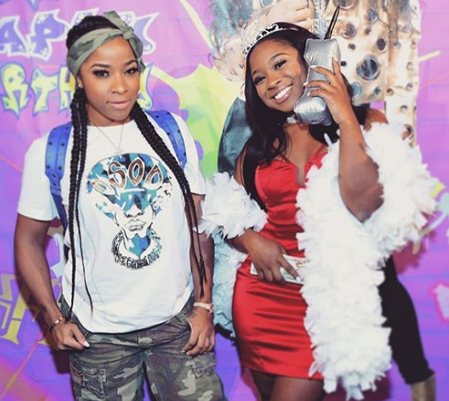 "Reginae takes a picture with her ""rock,"" a.k.a. Toya Wright."