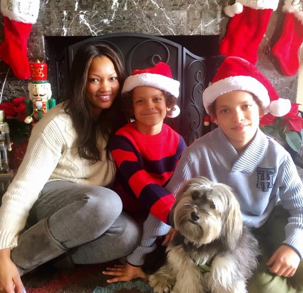 Garcelle and the kids take candids with the family dog.