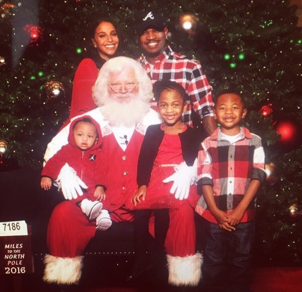 Ne-Yo and his blended family welcome Jolly Old Saint Nick with open arms.