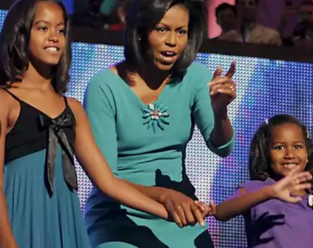 Michelle Obama and her daughters greet the crowd at the 2008 DNC.