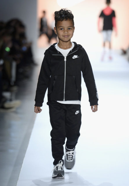 Saint Tillman's runway smirk is adorable as he casually strolls down the runway in classic NIKE black & white. Getty Images. Rookie USA Fashion Show, New York Fashion Week: The Shows at Gallery 3, Skylight Clarkson Sq on February 15, 2017 in New York City.