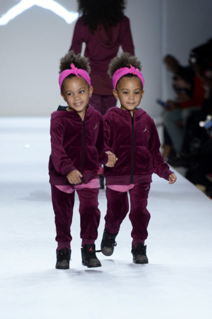 The McClure Twins are looking adorable as ever as the strut their stuff on the runway holding hands in purple NIKE with black shoes that have just the hint of pink to pull the look all together. Is it us or are these two the most adorable twins ever! Getty Images. Rookie USA Fashion Show, New York Fashion Week: The Shows at Gallery 3, Skylight Clarkson Sq on February 15, 2017 in New York City.