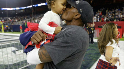 Jonathan Jones celebrates with his daughter Skyler after defeating the Atlanta Falcons in the NFL Super Bowl 51 football game Sunday, Feb. 5, 2017, in Houston. The Patriots defeated the Falcons 34-28