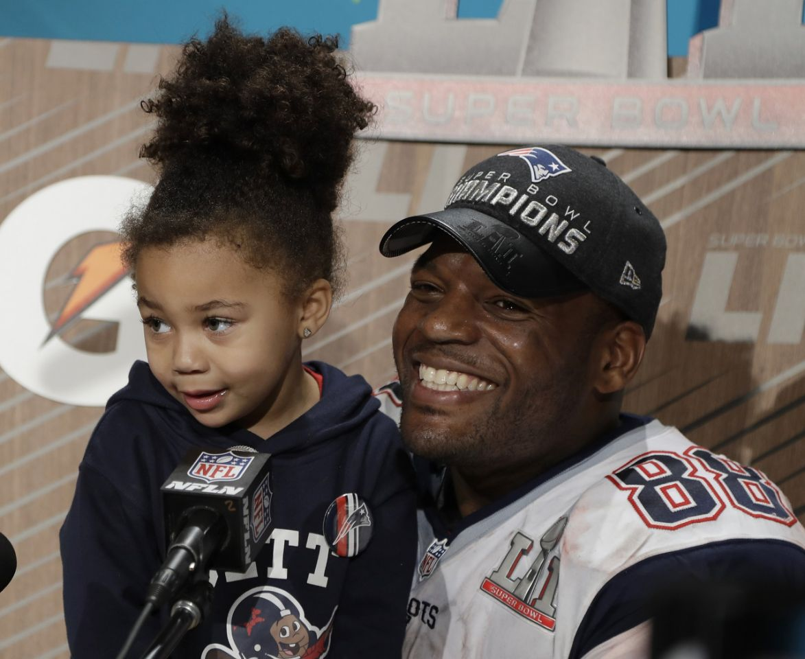 Martellus Bennett celebrates with his daughter  Austyn after defeating the Atlanta Falcons in the NFL Super Bowl 51 football game Sunday, Feb. 5, 2017, in Houston. The Patriots defeated the Falcons 34-28