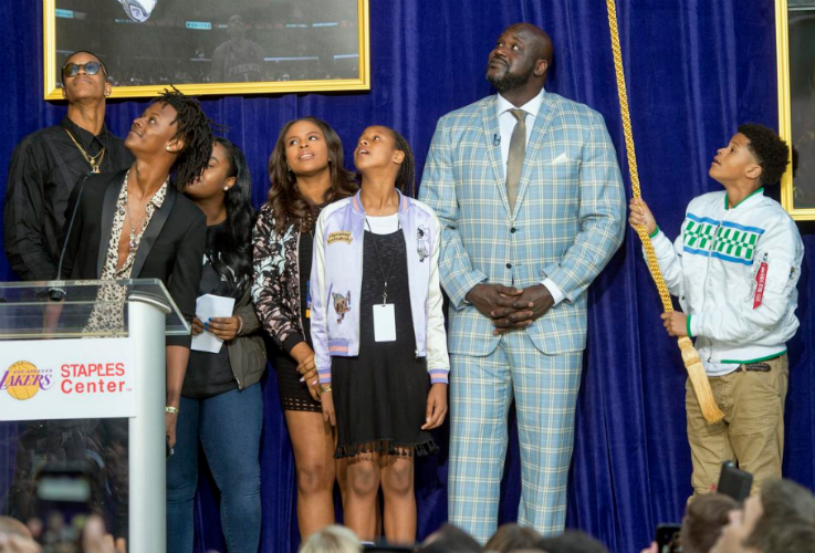 shaq receives flying high statue with his kids by his side