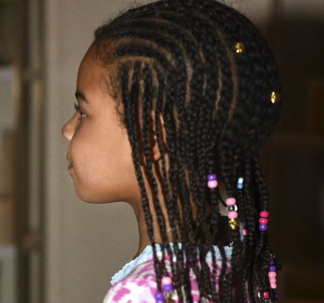 Blue Ivy shows off her braids.