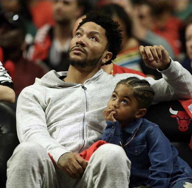 DERRICK ROSE CATCHES A CHICAGO 'BULLS' GAME WITH HIS SON