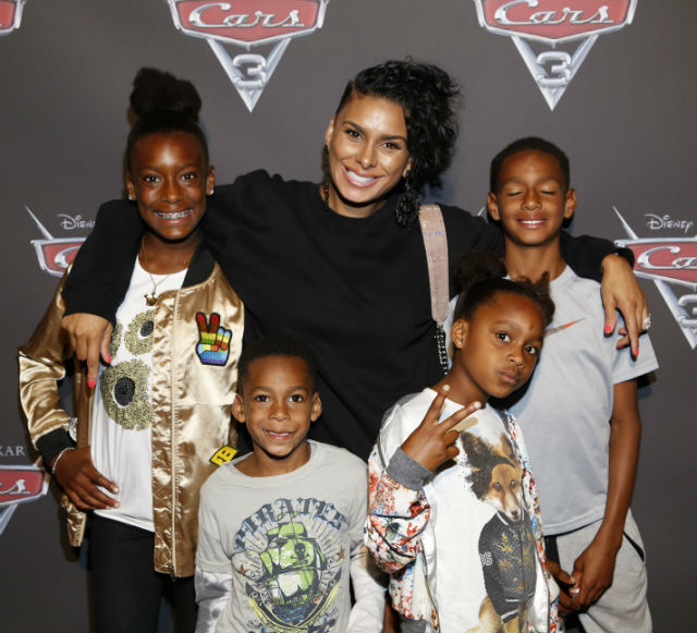 Laura Govan(VH1's Basketball Wives) and all four of her kids pose on the red carpet.