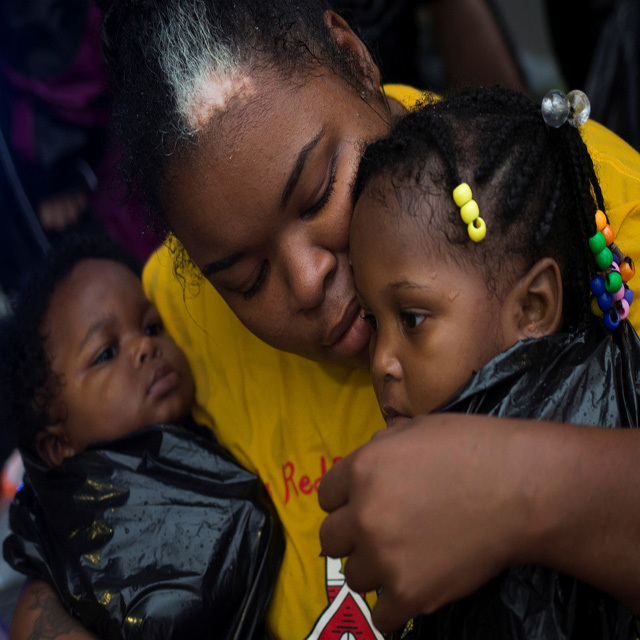 Laquanta Edwards holds her one year old daughter Ladaja (R) and nine-month-old son LaDarius after they arrived to high ground by boat due to floods caused by Tropical Storm Harvey along Tidwell Road in east Houston, Texas, U.S. August 28, 2017. REUTERS/Adrees Latif