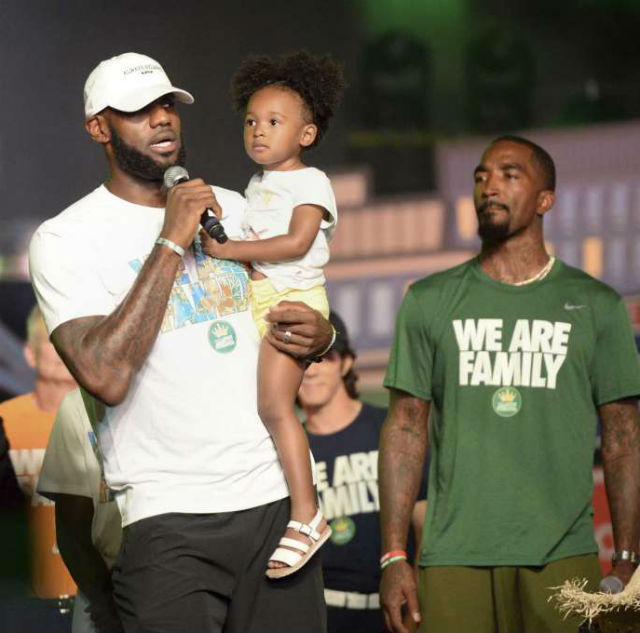 1753e26fe0a2 LeBron James and his family took the stage at his I PROMISE charity's event  on Tuesday. The celebrity father thanked the children who participate in  his ...