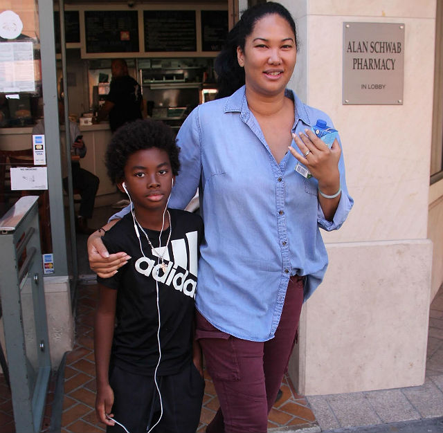 spotted kimora lee simmons spends the day with her