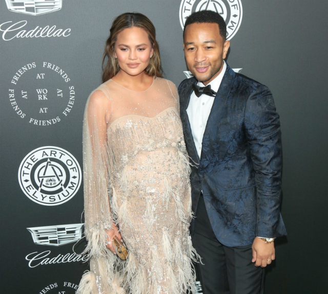 CHRISSY TEIGEN AND JOHN LEGEND BUMP AROUND ART OF ELYSIUM EVENT