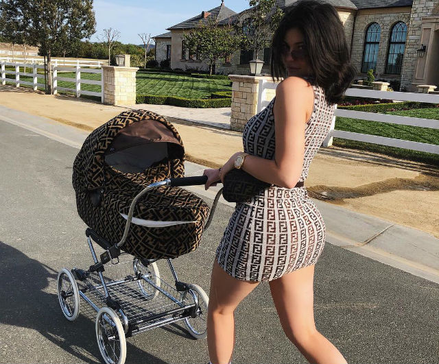 KYLIE JENNER TAKES STORMI ON A VERY EXPENSIVE STROLL