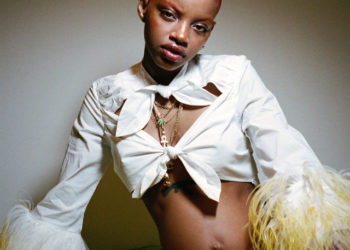 FENTY CAMPAIGN MODEL SLICK WOODS SHOWS OFF HER GROWING BABY BUMP