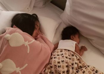 THIS INNOCENT PICTURE OF RAY J AND PRINCESS LOVES DAUGHTER SLEEPING ON HER STOMACH HAS CAUSED A BIG DEBATE