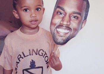 KIM KARDASHIAN SHARES PHOTO OF HER SON PRETENDING TO BE HIS DAD