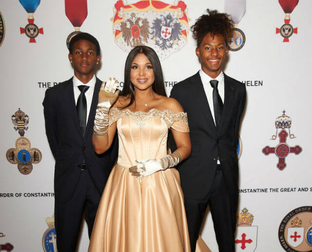 TONI BRAXTON GETS KNIGHTED WITH HER SONS BY HER SIDE