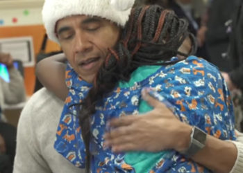 MERRY CHRISTMAS! BARACK OBAMA VISITS CHILDREN'S NATIONAL HOSPITAL FOR THE HOLIDAYS