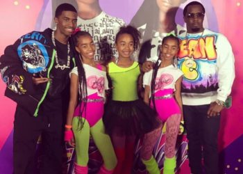 The twins pose next to dad Diddy, brother Christian Combs and sister Chance Combs.