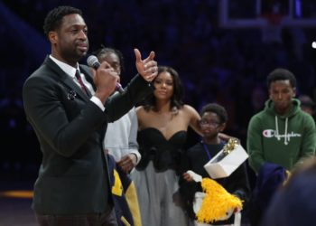 DWYANE WADE SURPRISED BY HIS KIDS AT MARQUETTE'S JERSEY RETIREMENT CEREMONY
