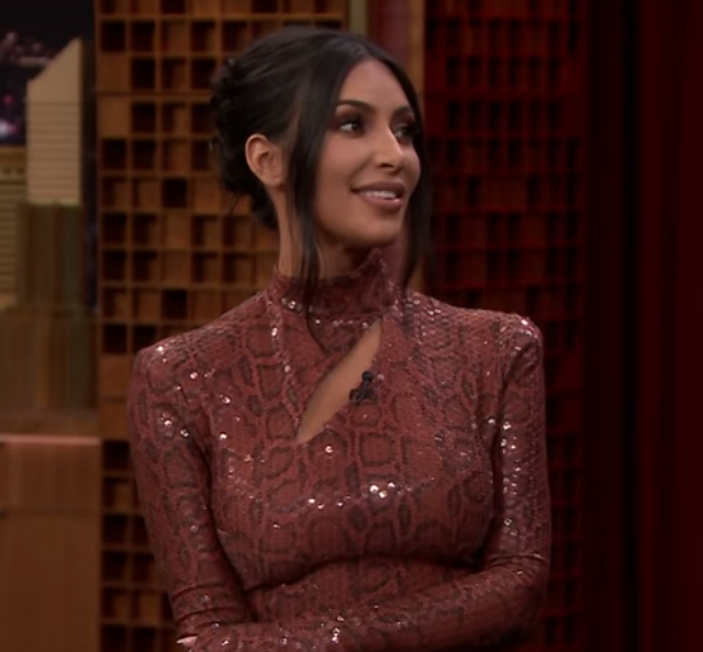 KIM KARDASHIAN SAYS FOUR KIDS WILL MAKE HER FEEL 'ENLIGHTENED AND CALM'