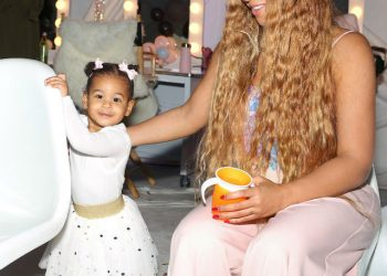 Beyonce with twin Rumi Carter at Blue Ivy's Rose Gold Party