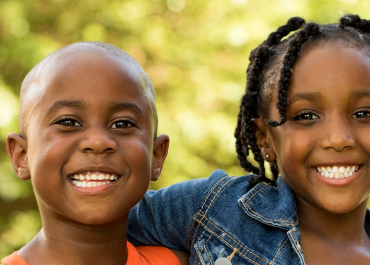 African American kids smiling.